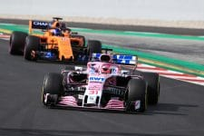 Esteban Ocon drives his Force India car on the final day of pre-season testing in front of Fernando Alonso