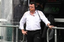 McLaren's Eric Boullier looks forlornly at a rainy Australia