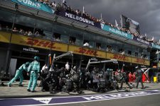 The Mercedes Pit Crew surround one of their cars