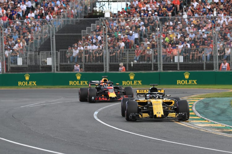 Nico Hulkenberg leads the Red Bull car of Daniel Ricciardo out of the second corner of Australia's Albert Park Circuit