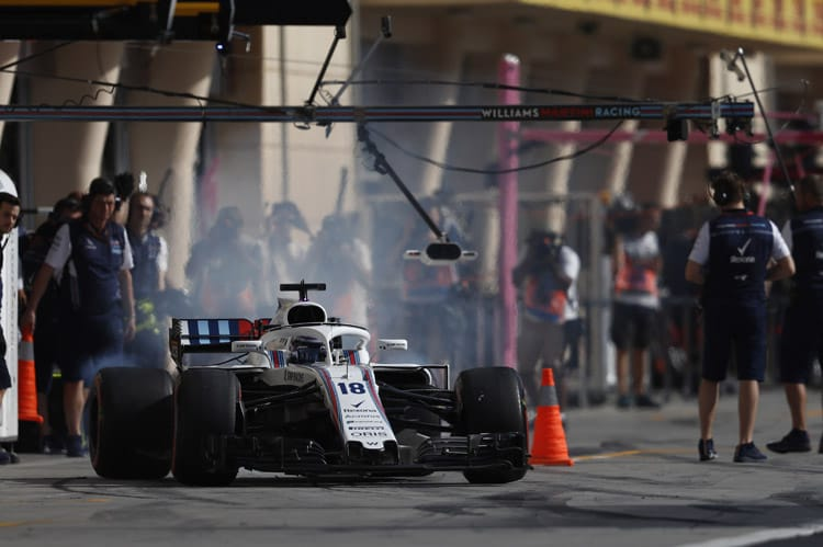 Lance Stroll leaves the Bahrain pits