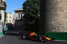 Max Verstappen drives by the castle in Baku