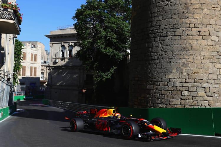 Max Verstappen drives by the castle in Baku