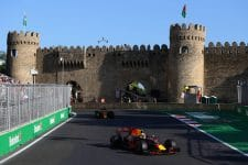 Two Red Bull cars drive past Baku's famous castle during the 2017 Azerbaijan Grand Prix