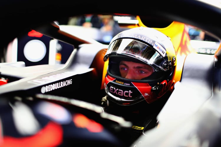Max Verstappen sits in his Red Bull car