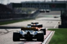 A Renault car follows a McLaren at the Chinese Grand Prix