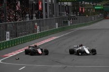 Marcus Ericsson drives past Kevin Magnussen, who he just hit