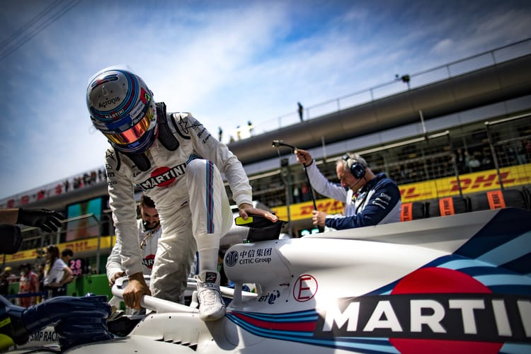 Sergey Sirotkin, Williams Racing, climbs out of his car on the grid.