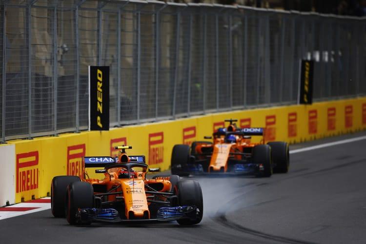 Both McLarens drive through the streets of Baku