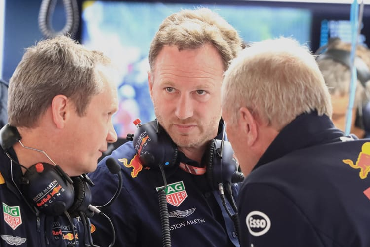 Christian Horner talks to other Red Bull Racing team members at the 2018 Spanish Grand Prix