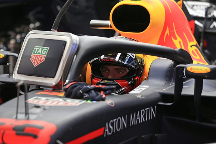 Max Verstappen looks at a screen during qualifying for the 2018 Spanish Grand Prix