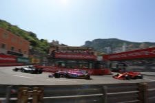 A Force India drives between a Mercedes and a Ferrari during qualifying for the 2018 Monaco Grand Prix