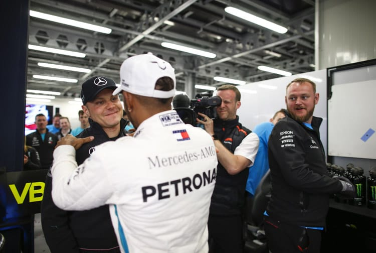 Lewis Hamilton and Valtteri Bottas hug it out after the Finn's retirement in the Azerbaijan Grand Prix