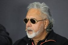 Vijay Mallya chats with sunglasses