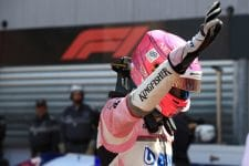 Esteban Ocon raises his hand in Monaco