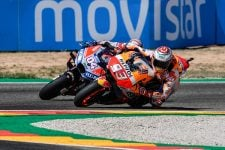 Marc Marquez passes Andrea Dovizioso (Photo Credit: MotoGP.com)