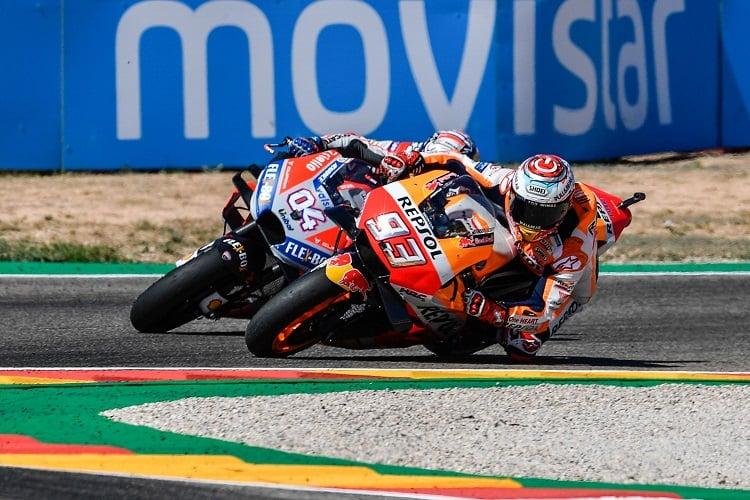 Marc Marquez passes Andrea Dovizioso (Photo Credit: MotoGP.com)
