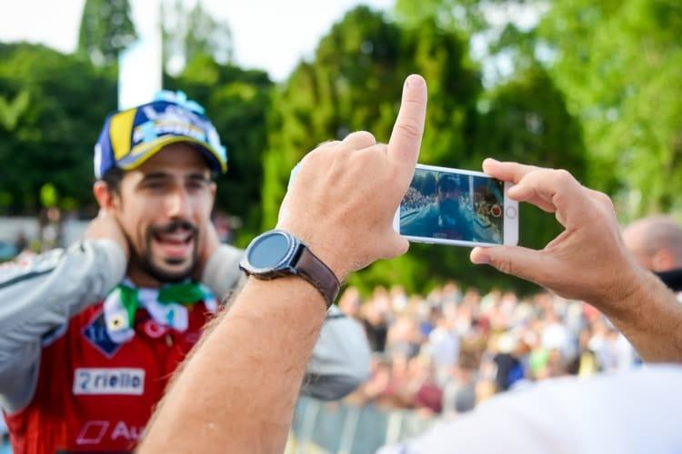 Lucas Di Grassi looking down lens