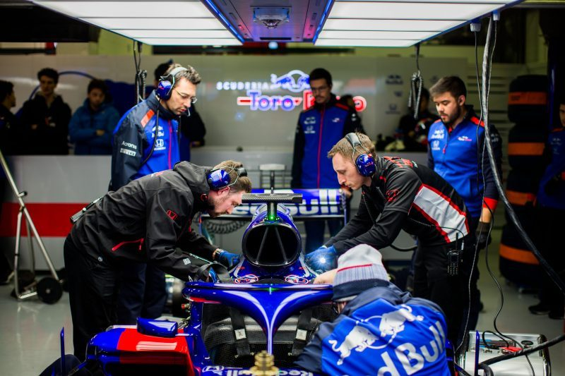 Red Bull Toro Rosso Honda mechanics working on the STR13 in the garage during pre-season testing in Barcelona.
