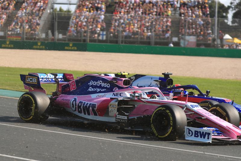 Formula 1 – Australian GP Race. Scuderia Toro Rosso STR14 – Daniil Kvyat and SportPesa Racing Point RP19 – Lance Stroll. Melbourne, Australia.