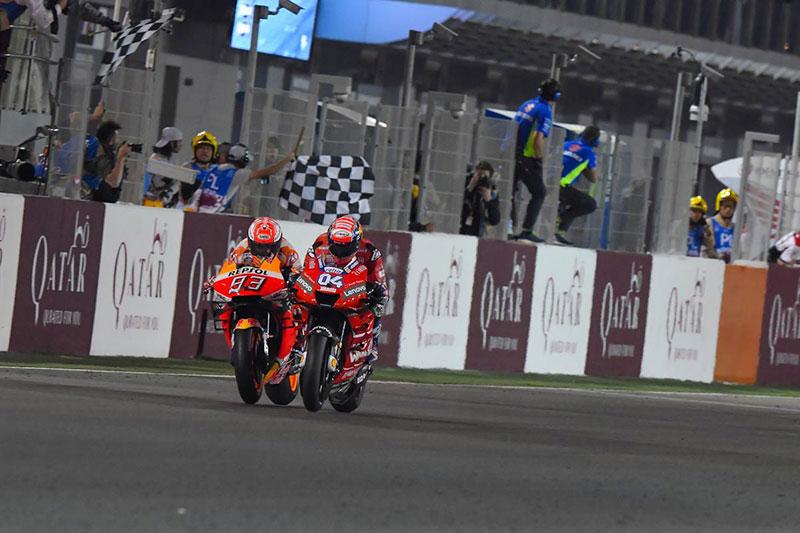 Dovizioso beats Marquez to win season opener