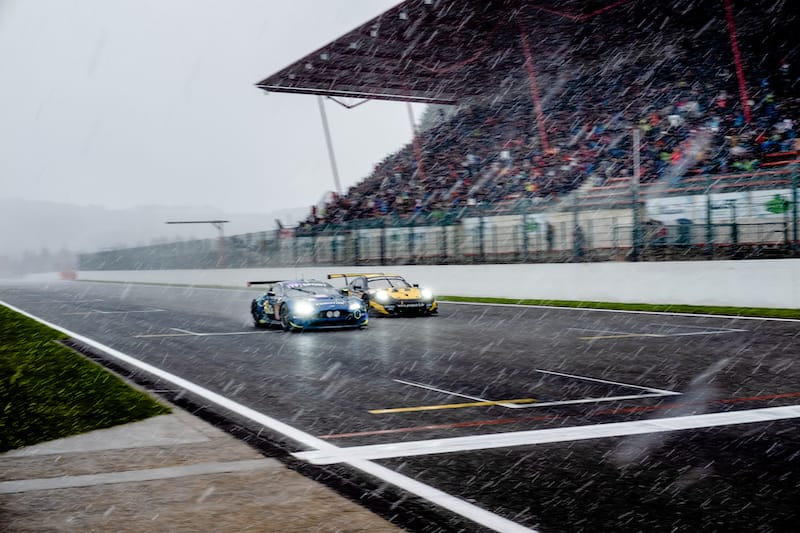 #90 TF Sport and #56 Team Project 1 LM GTE Am cars battling on track as snow falls.