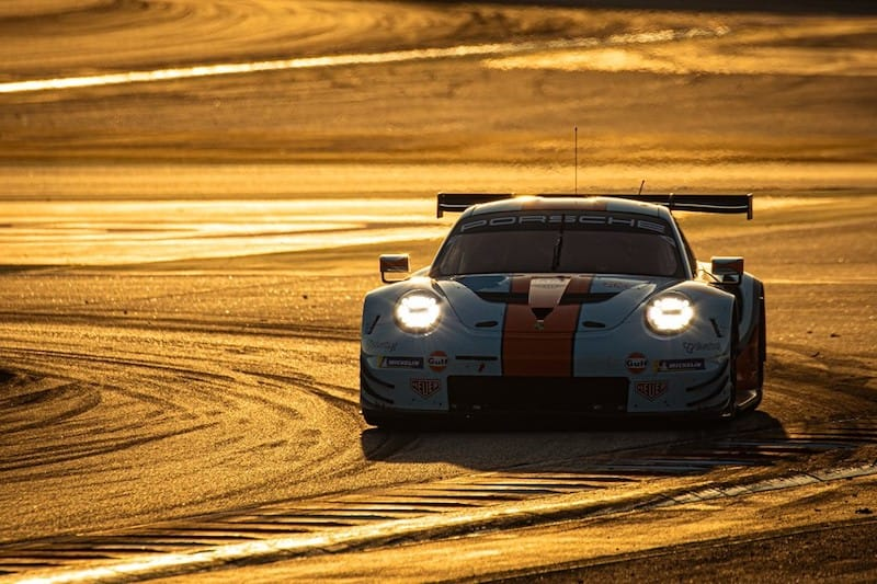 #86 Gulf Racing Porsche on track at Sunset