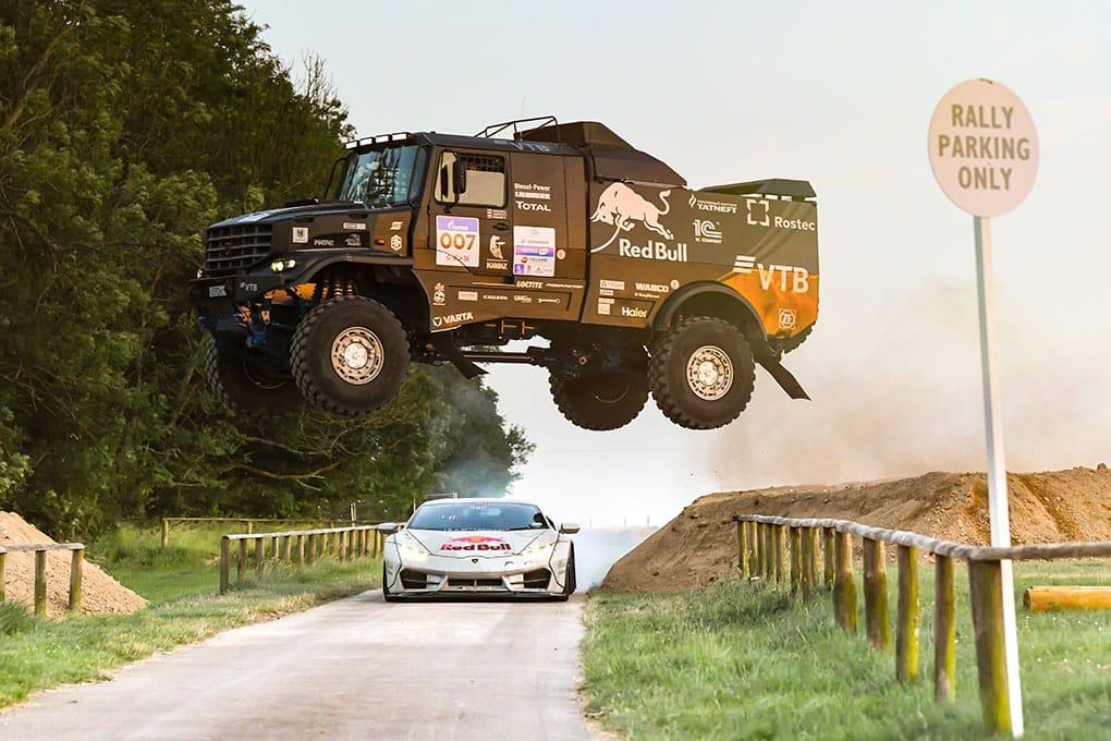 WATCH: Mad Mike take on a Dakar winning Kamaz Truck in his Lamborghini NIMBUL - The Checkered Flag