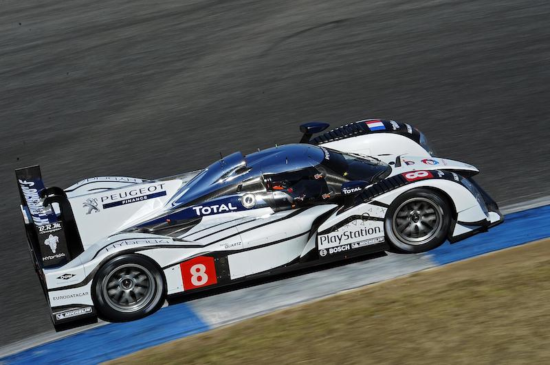 Peugeot Sport LMP1 racing car on track.