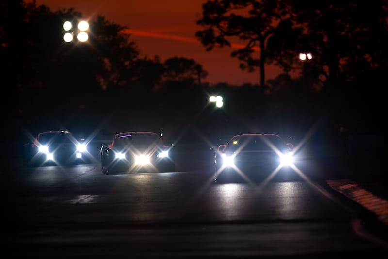 GT racers at night