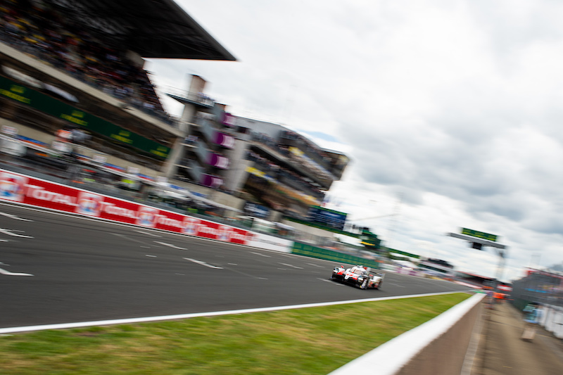 #7 Toyota on track down the main straight at Le Mans, 2019