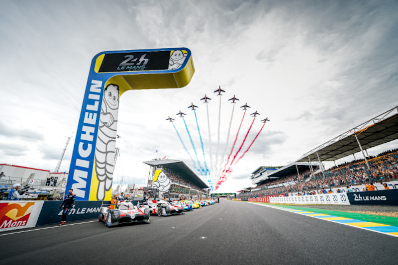 Grid at the start of the 24 Hours of Le Mans whist a flyby passes in the sky