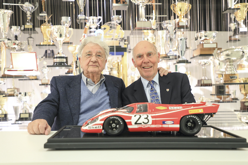Hans Herrmann (left) and Richard Attwood (right) with a model of their Le Mans-winning Porsche