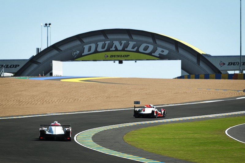 Digital render of both Toyota Gazoo Racing cars through Dunlop Corner at the Virtual 24 Hours of Le Mans
