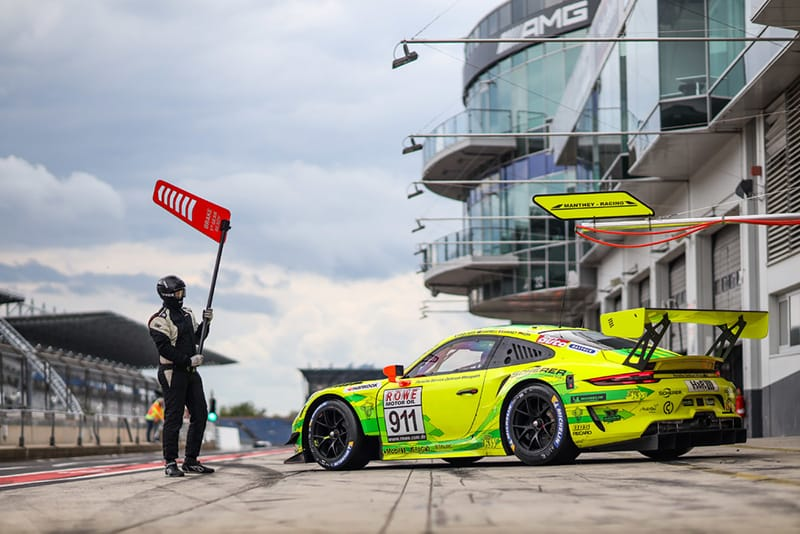 Manthey-Racing's #911 Porsche 911 GT3 R leaves the pits at the Nurburgring.